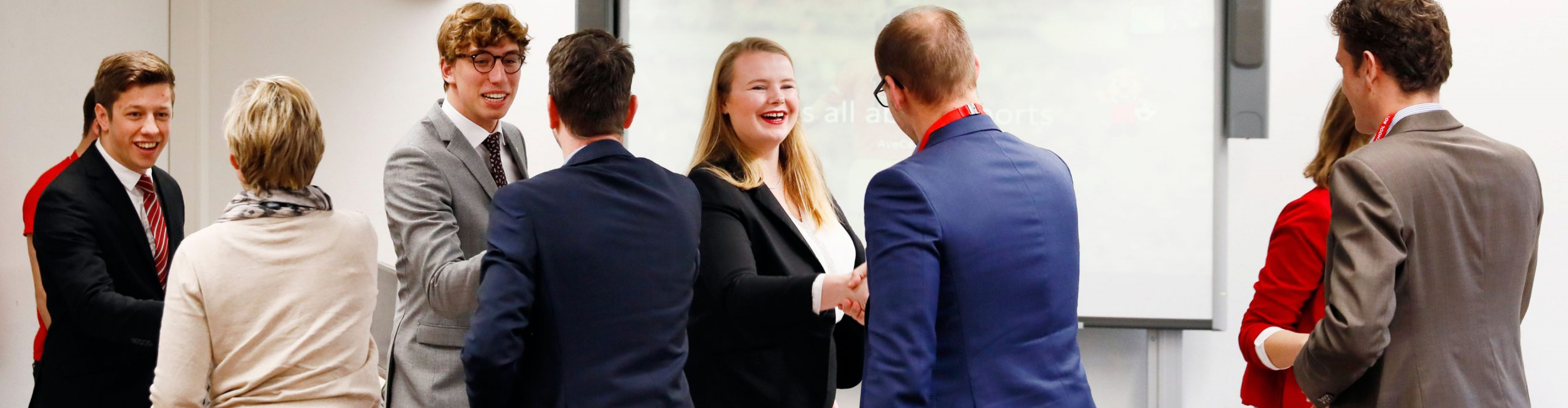 Students shaking hands of jury right before a presentation